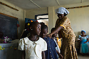 Children line up during a worship service at a small church in Monrovia, Liberia.