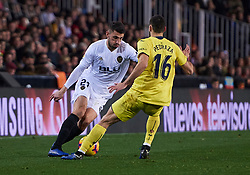 January 26, 2019 - Valencia, U.S. - VALENCIA, SPAIN - JANUARY 26: Cristiano Piccini, defender of Valencia CF with the ball front of Alfonso Pedraza, midfielder of Villarreal CF during the La Liga match between Valencia CF and Villarreal CF at Mestalla stadium on January 26, 2019 in Valencia, Spain. (Photo by Carlos Sanchez Martinez/Icon Sportswire) (Credit Image: © Carlos Sanchez Martinez/Icon SMI via ZUMA Press)