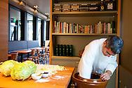 Chef/Owner Chris Israel prepping sauerkraut in his downtown Portland restaurant, Grüner.
