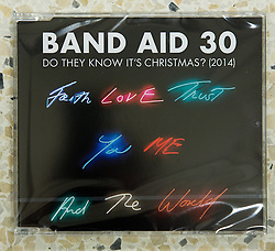 © Licensed to London News Pictures . 08/12/2014 . Manchester , UK . The Band Aid 30 CD at a branch of Asda in Trafford Park , Manchester , this morning ( 8th December 2014 ) as Sir Bob Geldof attends for the CD launch of Band Aid 30 . Photo credit : Joel Goodman/LNP