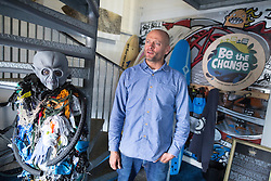 © Licensed to London News Pictures . 20/06/2016 . Cornwall, UK . Chief Executive of charity , Surfers Against Sewage , HUGO TAGHOLM , at the charity's office in St Agnes , alongside a collection of refuse collected from nearby St Agnes beach . Surfers Against Sewage coordinate volunteers across the UK to clean beaches in order to meet EU environmental standards , imposed to protect coastal wildlife . Photo credit : Joel Goodman/LNP
