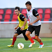 Galatasaray's players Milan BAROS (R) and Emre COLAK (L) during their training session at the Jupp Derwall training center in Istanbul Turkey on Thursday,  August 20, 2011. Photo by TURKPIX