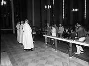 """Fr Niall O'Brien says Thanksgiving Mass.1984..16.07.1984..07.16.1984..16th July 1984..In celebration of his safe homecoming from the Philippines,Fr Niall O'Brien said a thanksgiving mass At Newtownpark Ave,Blackrock,Dublin. Along with two other priests and six lay people,Fr Niall was falsly accused of multiple murders.They became known as """"The Negros Nine"""".After President Reagan visited Ireland,The American government put pressure on the Marcos regime and all charges were dropped and all were fully exonerated....Photograph taken as members of the congregation present the gifts to the altar...Note; Fr O'Brien, who was born in Dublin in 1939,died in Pisa, Italy in 2004."""