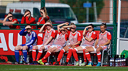 YSTRAD MYNACH, WALES - Wednesday, April 5, 2017: Wales substitutes shield their eyes from the sun during the Women's International Friendly match against Northern Ireland at Ystrad Mynach. (Pic by Laura Malkin/Propaganda)