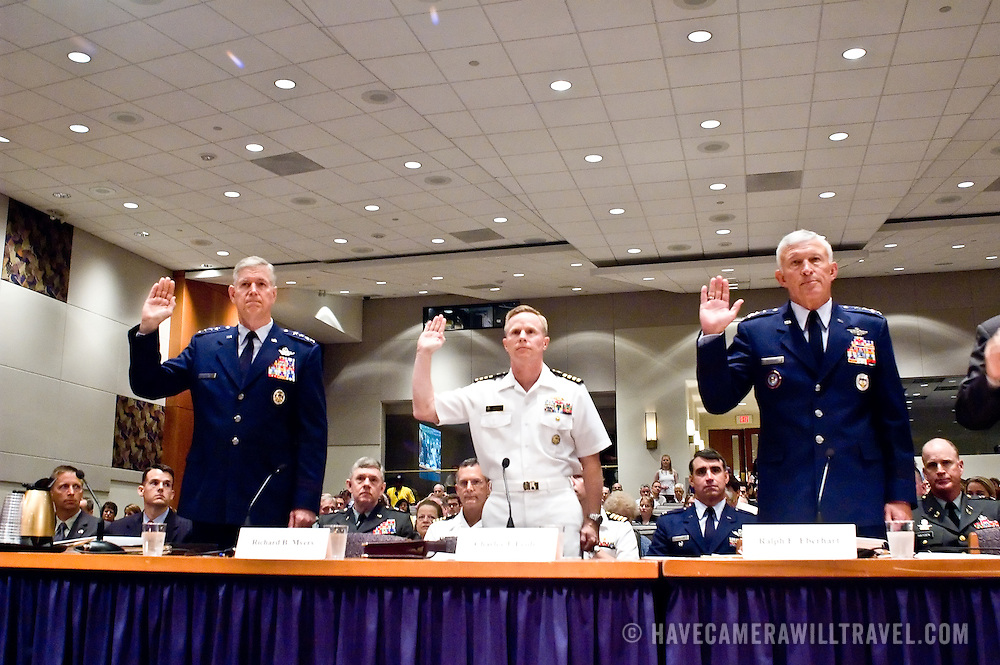 """The panel being sword in. From left: General Richard Myers, Chairman of the Joint Chiefs of Staff; Admiral Charles Joseph Leidig, Commandant of Mishipmen, United States Naval Academy, General Ralph Eberhart, Commander, NORAD and US Northern Command; Major General Larry Arnold (Ret.), Former Commander, Continental United States NORAD Region. Panel: Military Response on 9/11. The 9/11 Commission's 12th public hearing on """"The 9/11 Plot"""" and """"National Crisis Management"""" was held June 16-17, 2004, in Washington, DC."""
