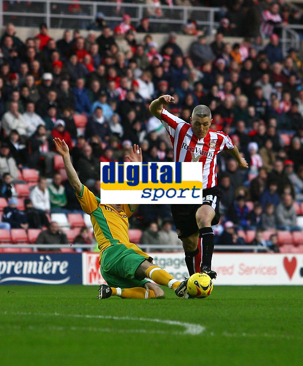 Photo: Andrew Unwin.<br />Sunderland v Norwich City. Coca Cola Championship. 02/12/2006.<br />Norwich's Andy Hughes (L) looks to tackle Sunderland's Graham Kavanagh (R).