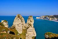 France, Seine-Maritime (76), Pays de Caux, Côte d'Albâtre, Etretat, la falaise d'Aval et la Chambre des Demoiselles avec en arrière plan la falaise d'Amont et l'église Notre-Dame-de-la-Garde // France, Seine-Maritime (76), Pays de Caux, Côte d'Albâtre, Etretat, the Aval cliff and the Chambre des Demoiselles with in the background the Amont cliff and the Notre-Dame-de-la church -Keep