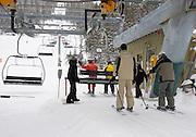 Skiers take chair lift at Taos Ski Valley