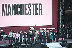 © Licensed to London News Pictures . 04/06/2017 . Manchester , UK . Dignitaries , politicians and sports stars on the stage ahead of the show . The One Love Manchester benefit concert for victims of the Manchester Arena terrorist attack , at the Emirates Old Trafford Cricket Stadium . Ariana Grande, Justin Bieber, Coldplay, Katy Perry, Miley Cyrus, Pharrell Williams, Usher, Take That, Robbie Williams, Black Eyed Peas and Niall Horan are amongst the performers. Photo credit : Joel Goodman/LNP