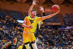 Mar 20, 2019; Morgantown, WV, USA; West Virginia Mountaineers guard Jordan McCabe (5) shoots under the basket during the second half against the Grand Canyon Antelopes at WVU Coliseum. Mandatory Credit: Ben Queen