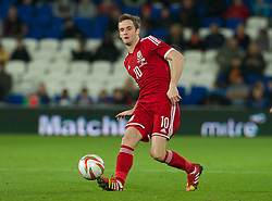 CARDIFF, WALES - Saturday, November 16, 2013: Wales' Andy King in action against Finland during the International Friendly match at the Cardiff City Stadium. (Pic by David Rawcliffe/Propaganda)