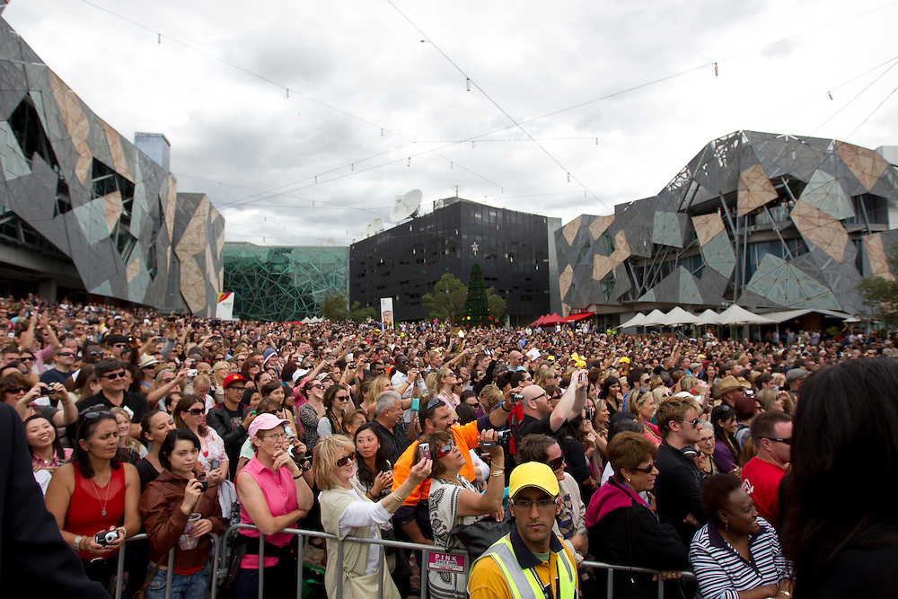 A general view of the crowd of 12,000 people gathered to see Oprah Winfrey at a public event at Federation Square on December 10, 2010 in Melbourne, Australia. Oprah Winfrey is in Australia with 302 audience members from the US, Canada and Jamaica and will tape episodes of the 25th and final season of 'The Oprah Winfrey Show' from the Sydney Opera house next week. The shows will air in the US and Australia in January 2011.