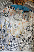 Artwork of sieging soldiers battling a walled city. The Banqueting Hall was commissioned by David von Winkelsheim (1499-1525), the last Abbot of Saint George's. The mostly secular nature of the room's colorful historical frescos saved them from the iconoclasm of the Reformation in 1525. St. George's Abbey (Kloster Sankt Georgen) was founded around 1007 as a Benedictine monastery in Stein am Rhein village, on the banks of the Rhine at the western end of Lake Constance. The fascinating Klostermuseum is one of Switzerland's most important historic buildings from the late Middle Ages and early Renaissance, built in the 1300s to 1500s.