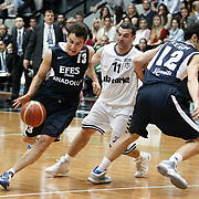 Besiktas's Cuneyt ERDEN (C) and Efes Pilsen's Ender ARSLAN (L)  during their Turkish Basketball league derby match Besiktas between Efes Pilsen at the BJK Akatlar Arena in Istanbul Turkey on Saturday 30 April 2011. Photo by TURKPIX