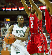 Keenan Evans (12) of Richardson Berkner drives to the basket against Fort Bend Travis during the UIL Conference 5A semifinals at the Frank Erwin Center in Austin on Friday, March 8, 2013. (Cooper Neill/The Dallas Morning News)