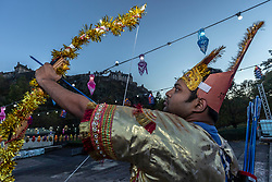 The Lord Provost of Edinburgh, Frank Ross, unveils the Sharing the Ramayana: The story of Diwali, an exhibition of 15 stunning illuminated Indian puppetry tableaux.<br /> <br /> Pictured: Participant in the Edinburgh Diwali celebrations