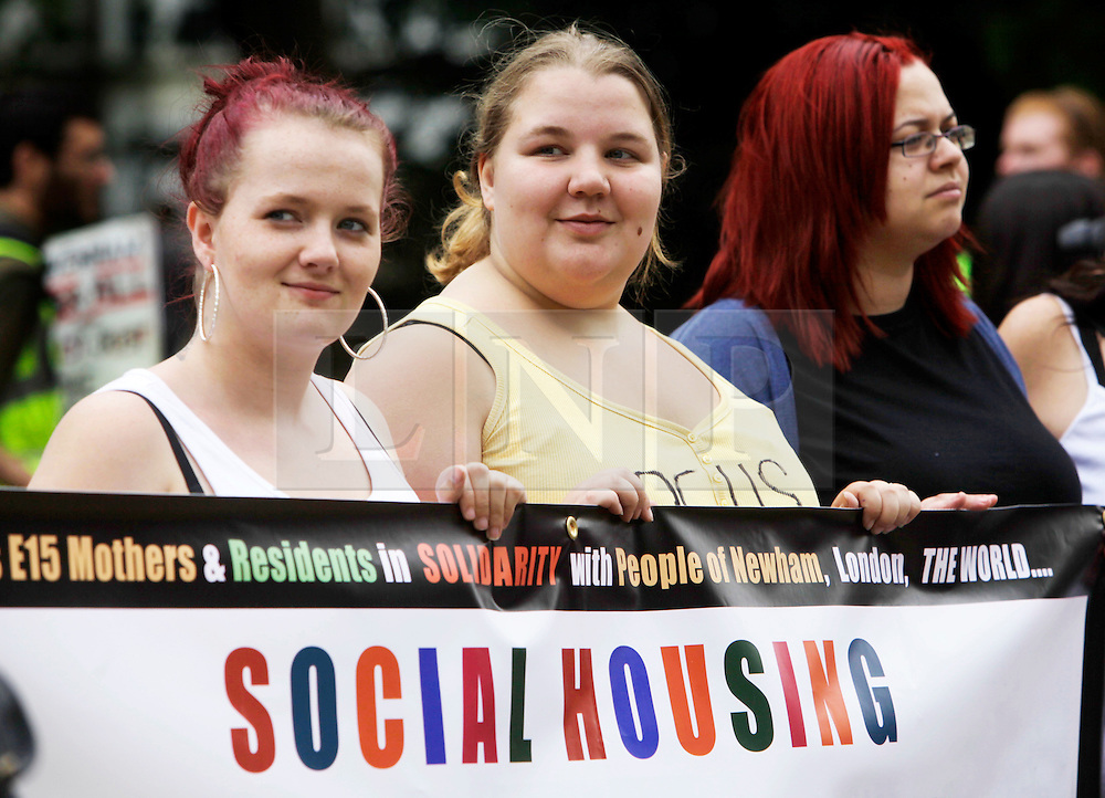 Newham, London. 05/07/2014<br /> From left, Sam Middleton, Jasmin Stone and Jessica Harper. Three of the Focus E15 Mothers campaigns. A group of young single mothers who were placed into temporary accommodation by Newham council, after being evicted from council housing, were warned they could be re-housed as far away as Birmingham, Manchester and Hastings. Some mothers have already relocated outside of London due to the lack of affordable social housing.<br /> Photo: Anna Branthwaite/LNP