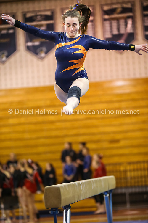 (3/1/14, SHREWSBURY, MA) Newton South's Kaela Meyer competes on the balance beam during the state gymnastics meet at Shrewsbury High School on Saturday. Daily News and Wicked Local Photo/Dan Holmes