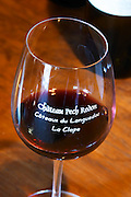 Glass embossed with Chateau Pech Redon, Coteaux du Languedoc La Clape. Chateau Pech-Redon. La Clape. Languedoc. France. Europe.