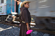 """Tomás González, director of migrants shelter """"La 72"""", looks at the train passing by in Tequisquiapan, Querétaro, on October 24th, 2012 (Photo: Prometeo Lucero)"""