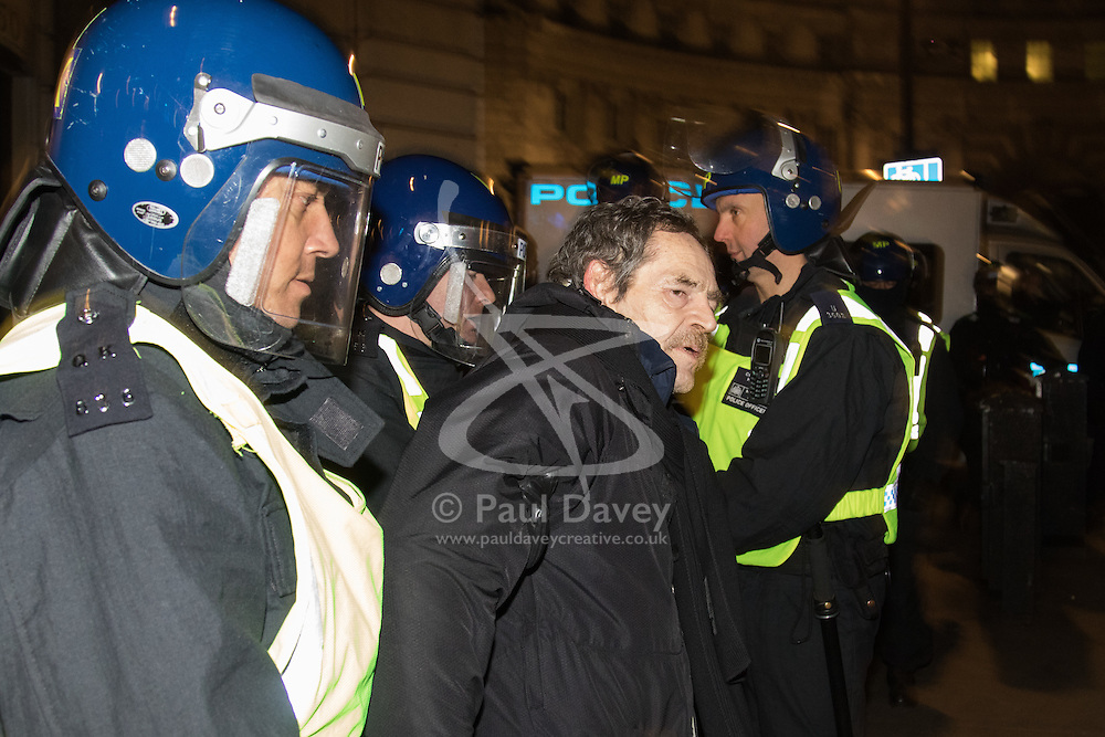 London, November 5th 2016. Anti-capitalists and anarchists participate in the Million Mask March, an annual event that happens on November 5th each year in cities across the world, as part of a protest against the establishment. Many of the protesters wear Guy Fawkes masks, often associated with the internet activism group Anonymous. PICTURED: A protester is arrested by riot police as they try to clear Trafalgar Square.