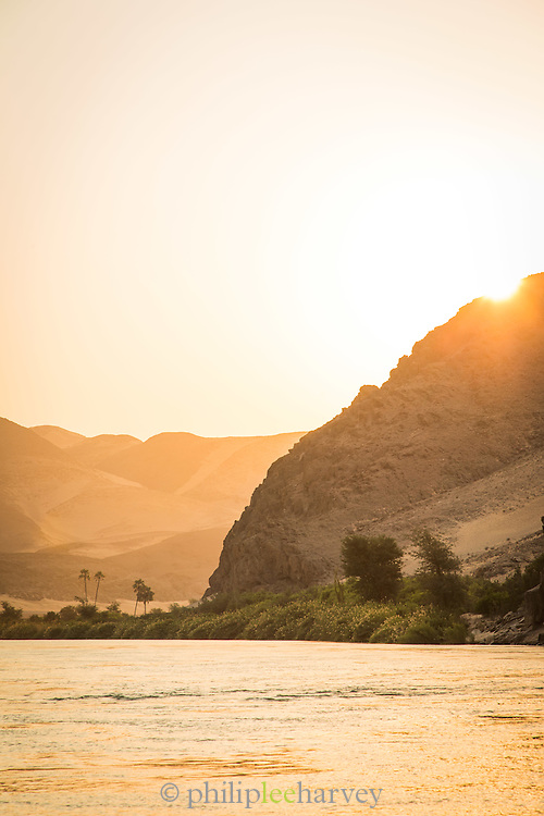 Kunene River mountains in the background, sunset, Hartmanns Valley, Northern Namibia, Southern Africa