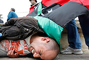A injured anti-Gaddafi protester lies on the ground after a clash with police outside the Libyan Embassy in Attard, outside Valletta, March 21, 2011. Several arrests were made when anti-Gaddafi protesters threw stones at pro-Gaddafi demonstrators and tried to approach the embassy gates, according to local media...REUTERS/Darrin Zammit Lupi (MALTA)