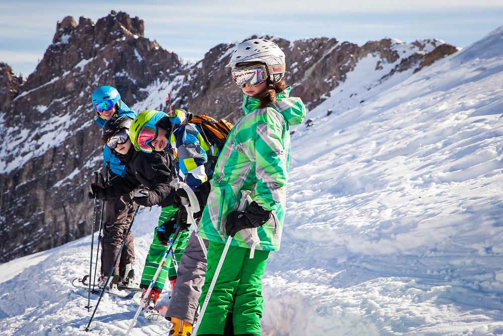 Teenagers take Devil's Castle traverse at Alta Ski Area.