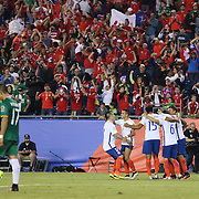 FOXBOROUGH, MASSACHUSETTS - JUNE 10: Arturo Vidal #8 of Chile is congratulated by team mates after scoring the winning goal from the penalty spot in time added on beating goalkeeper Carlos Lampe #1 of Bolivia during the Chile Vs Bolivia Group D match of the Copa America Centenario USA 2016 Tournament at Gillette Stadium on June 10, 2016 in Foxborough, Massachusetts. (Photo by Tim Clayton/Corbis via Getty Images)