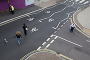"""An elderly man struggles to cross the road near the soon-to-be demolished Aylesbury Estate, on 4th September 2018, in Southwark, London, England. The Aylesbury Estate contained 2,704 dwellings in approximately 7500 residents and built between 1963 and 1977. There were major problems with the physical buildings on the estate and the poor perception of estates in Britain as a whole have led to the Aylesbury Estate gaining the title of """"one of the most notorious estates in the United Kingdom."""