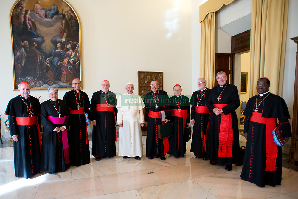 File photo - Pope Francis poses with cardinals during a meeting at the Vatican on October 1, 2013 for a first round of talks on reforming the Catholic Church. Eight cardinals began closed-door meetings with Pope Francis on to help him reform the Vatican's troubled administration, the Curia, and map out possible changes in the worldwide Church. Left to right : Fancisco Javier Errazuriz Ossa, Marcello Semeraro (secretary), Oswald Gracias, Reinhard Marx, pope Francis, Andres Rodriguez Maradiaga, Giuseppe Bertello, Sean Patrick O'Malley, George Pell, Laurent Monsengwo Pasinya. Cardinal George Pell has been found guilty of sexual offences in Australia, making him the highest-ranking Catholic figure to receive such a conviction. Pell abused two choir boys in the rooms of a Melbourne cathedral in 1996, a jury found. He had pleaded not guilty. The verdict was handed down in December, but it could not be reported until now due to legal reasons. Pell is due to face sentencing hearings from Wednesday. He has lodged an appeal against his conviction. Photo by ABACAPRESS.COM