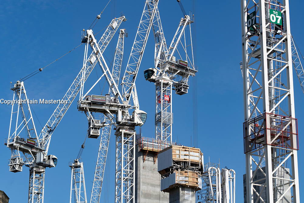 Many construction tower cranes at construction site of redevelopment of St James Centre in Edinburgh, Scotland UK