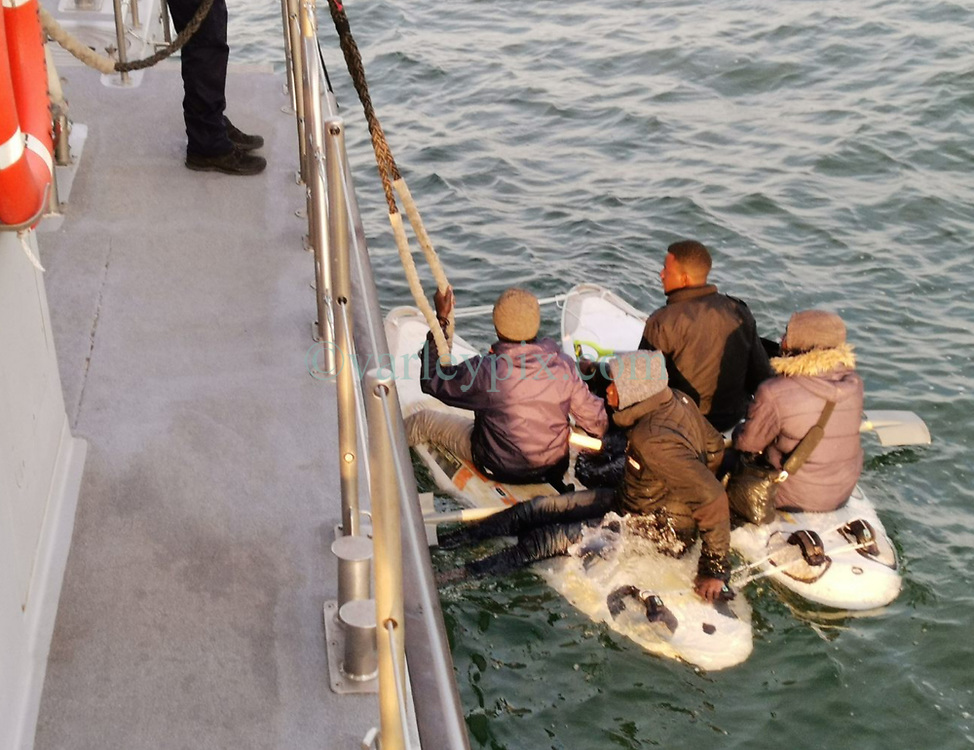 10 June 2020. <br /> <br /> Collect Photo from VCSM Escaut rescue craft (French Coastguard) between Calais and Dover, France.<br /> <br /> A spokesman for France's Channel Prefecture said the photo was shot on Wednesday June 10, three miles off Calais.<br /> <br /> 'Three men and a woman were attempting to paddle across the channel on two windsurf boards that had been tied together with rope,' adding: 'Shovels were being used as oars.'<br /> <br /> A Mayday was put out by a Dunkirk Seaways ferry after the group was spotted at 6.35am, in a relatively calm sea. <br /> <br /> The VCSM Escaut rescue craft attended the scene, and rescued the migrants, who were all suffering from mild hypothermia. <br /> <br /> The group was returned to France, and later 'processed' by Border Police, who could provide no further details of what happened to them.<br /> <br /> The Prefecture spokesman said migrants were increasingly using makeshift crafts because of the difficulty of getting hold of motorboats.<br /> <br /> So far in June, 250 migrants have reached Britain by boat - including a record single-day figure of 166.<br /> <br /> Photo© courtesy; French Coast Guard/VCSM Escaut rescue craft/Channel Prefecture provided to Charlie Varley/varleypix.com