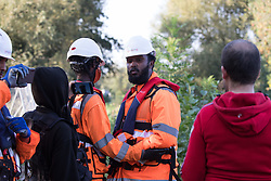 An HS2 security guard is filmed by an anti-HS2 activist after he pocketed an item belonging to a fellow activist during tree felling works alongside HOAC lake in connection with the HS2 high-speed rail link on 21 September 2020 in Harefield, United Kingdom. Anti-HS2 activists continue to try to prevent or delay works for the controversial £106bn HS2 high-speed rail link on environmental and cost grounds from a series of protection camps based along the route of the line between London and Birmingham.