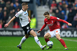 Derby Midfielder Jeff Hendrick (IRL) tackles Nottingham Forest Midfielder Chris Cohen (ENG) during the first half of the match - Photo mandatory by-line: Rogan Thomson/JMP - Tel: Mobile: 07966 386802 19/01/2013 - SPORT - FOOTBALL - Pride Park - Derby. Derby County v Nottingham Forest - npower Championship. The meeting of these two local sides is known as the East Midlands Derby with the winner claiming the Brian Clough Trophy.