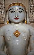 White marble Buddha at the Salim Singh-Ki-Haveli temple Jaisalmer Rajasthan 2011