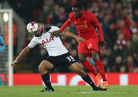 Football - 2016 / 2017 League [EFL] Cup - Fourth Round: Liverpool vs. Tottenham Hotspur<br /> <br /> Divock Origi of Liverpool and Cameron Carter-Vickers of Tottenham Hotspur during the match at Anfield.<br /> <br /> COLORSPORT/LYNNE CAMERON