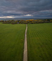 Aerial view of an empty dirt road just before the storm on the island of Vormsi, Estonia