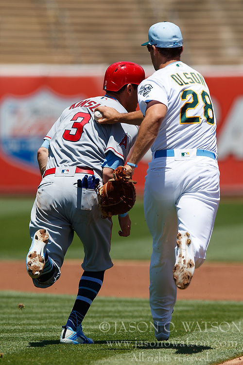 OAKLAND, CA - JUNE 17: Ian Kinsler #3 of the Los Angeles Angels of Anaheim is caught in a rundown by Matt Olson #28 of the Oakland Athletics during the first inning at the Oakland Coliseum on June 17, 2018 in Oakland, California. The Oakland Athletics defeated the Los Angeles Angels of Anaheim 6-5 in 11 innings. (Photo by Jason O. Watson/Getty Images) *** Local Caption *** Ian Kinsler; Matt Olson