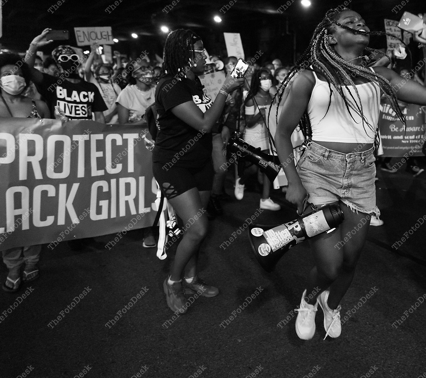 Demonstrators are shown during a Black Lives Matter Movement March for Black Womxn Protest iAlong the FDR in New York, New York  ©Brian Branch-Price