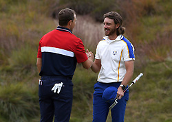 Team Europe's Tommy Fleetwood (right) and Team USA's Joseph Spieth shake hands after their singles match on the 18th green during day three of the 43rd Ryder Cup at Whistling Straits, Wisconsin. Picture date: Sunday September 26, 2021.