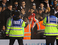 A fan is escorted out after inciting the Partizan crowd<br /> <br /> Europa League Group C- Tottenham vs Partizan Belgrade - White Hart Lane - England - 27th November 2014 - Picture David Klein/Sportimage