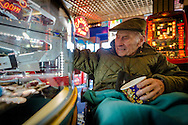 EMBARGOED 00:01 Wednesday 22nd February; 2017.<br /> <br /> A resident from Chestnut View care home playing the penny arcade games while visiting the seafront in Southsea, Hampshire. They are amongst the first of 100,000s of old and vulnerable people to enjoy new Out and About excursions after Oomph! announces nationwide expansion plans today (Wednesday 22nd February).<br /> Out and About tackles a lack of outings for people in care settings due to social care funding cuts. Innovative model offers economies of scale on excursion planning, transport and conductors across care settings in an area.<br /> 80 Out and About minibuses will hit the road in first year thanks to £1.5million investment from Mike Parsons, Care and Wellbeing Fund and Nesta Impact Investments.<br /> Photograph by Christopher Ison ©<br /> 07544044177<br /> chris@christopherison.com<br /> www.christopherison.com