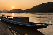 Boat on the Mekong River at sunset, Luang Prabang, Laos.