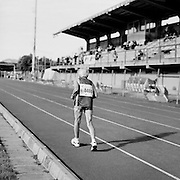 Senior athlete Louise Adams, of the United States, runs as the sole competitor in her 85-89-year-old age division 5000 meter run at the 2007 World Masters Championships Stadia (track and field competition) in Misano Adriatico, Italy on September 7, 2007. ..9,000 male and female athletes over the age of 35 from 90 countries competed in two weeks of track and field events at the 17th annual event. The event is run by  the World Association of Masters Athletes, the organization designated by the IAAF (The International Association of Athletics Federations) to conduct the worldwide sport of masters athletics. The organization runs competitions and maintains record standings in the 5-year increment age divisions.  ...