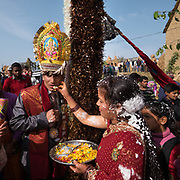 The groom is welcomed at the bride's home. Traditional wedding in the Himalaya.
