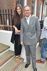 ELIZABETH SALTZMAN and AA GILL at the launch of the new collection from Limoland held at Anderson & Sheppard's Haberdashery, 17 Clifford Street,London on 16th June 2014.