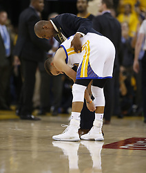 June 12, 2017 - Oakland, CA, USA - The Golden State Warriors' Stephen Curry is checked following a scuffle against the Cleveland Cavaliers in the second quarter of Game 5 of the NBA Finals at Oracle Arena in Oakland, Calif., on Monday, June 12, 2017. (Credit Image: © Nhat V. Meyer/TNS via ZUMA Wire)