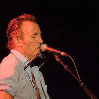 Bruce Springsteen sings during a benefit concert for the American Red Cross at the Paramount Theater.