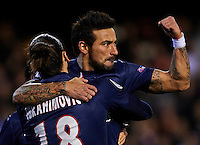 VALENCIA, SPAIN - FEBRUARY 12:  Ezequiel Lavezzi of Paris Saint-Germain celebrates scoring with his teammate  Zlatan Ibrahimovic during the UEFA Champions League Round of 16 match between Valencia CF and Paris St Germain at Estadi de Mestalla on February 12, 2013 in Valencia, Spain.  (Photo by Manuel Queimadelos Alonso/Getty Images)